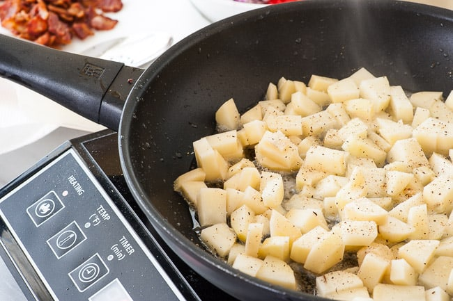 Potatoes being browned for breakfast hash.