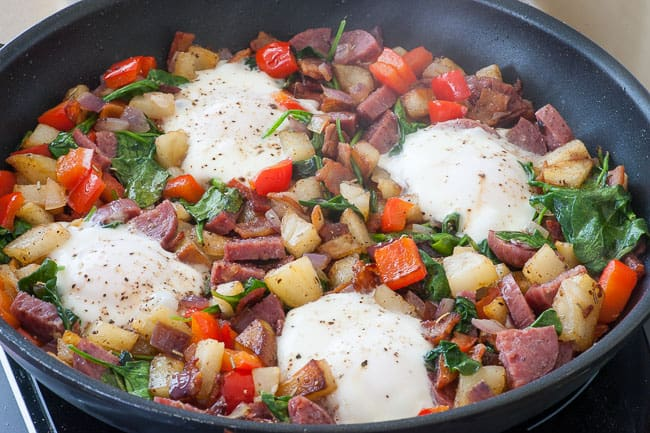 Hash with bacon and salami. Add a fried egg for a perfect meal. | joeshealthymeals.com
