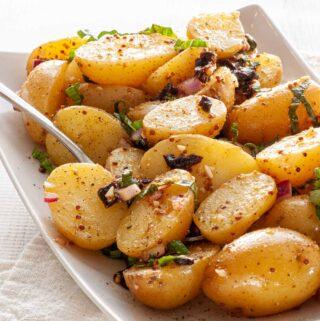 Plate of warm potato salad.
