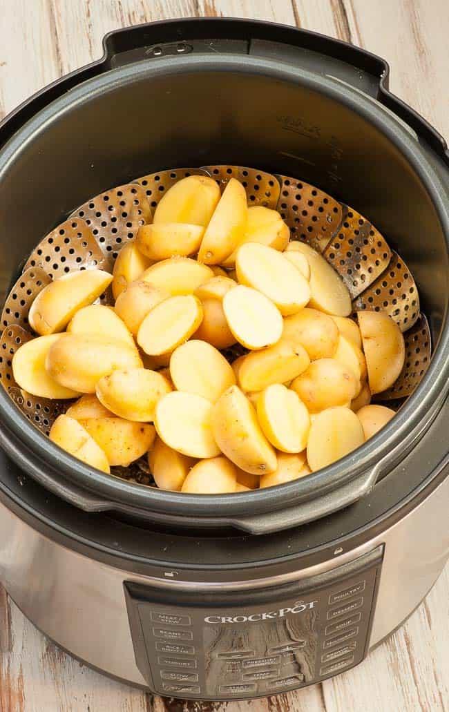 Crock-Pot pressure cooker set to steam the potatoes.