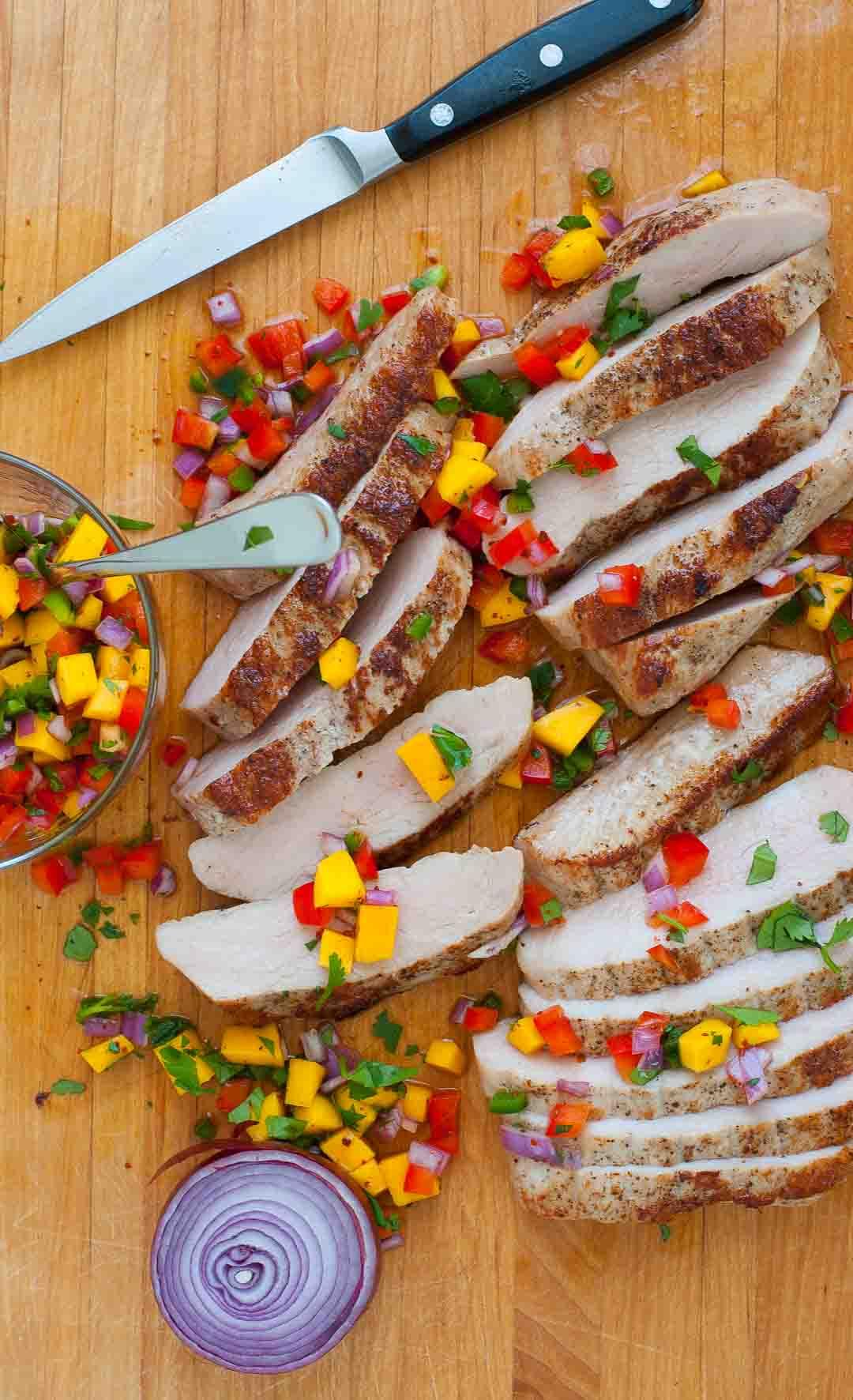 Healthy pork tenderloin steaks with spicy salsa. | joeshealthymeals.com