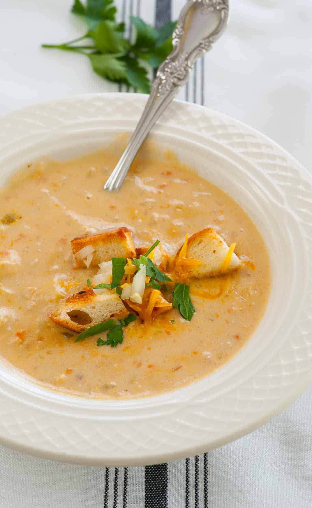 Bacon cheeseburger soup with croutons and shredded cheese.   joeshealthymeals.com