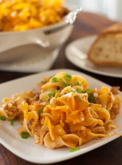 Cheesy beef noodle bake served warm with a good, crusty bread. | joeshealthymeals.com