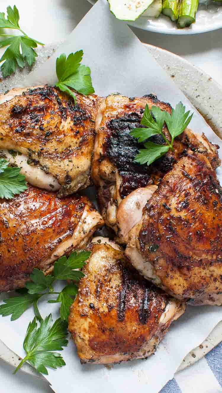 plate of grilled chicken thighs