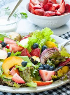Fresh garden greens salad with fruit and yogurt dressing. | joeshealthymeals.com