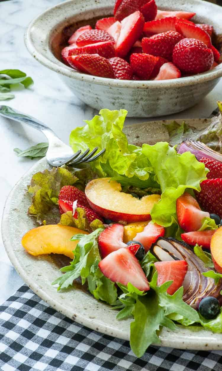 garden salad with strawberries and peach slices