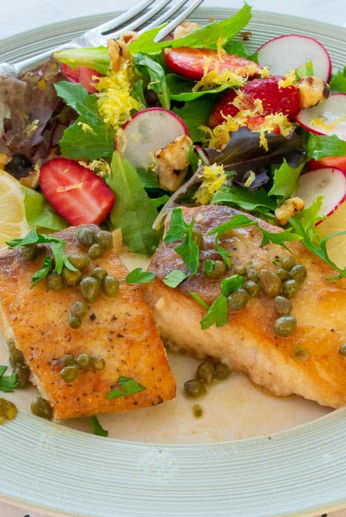 Fried fish and salad on a plate..