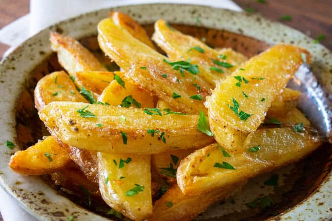 Golden crispy oven fries are crunchy on the outside and creamy smooth on the inside.