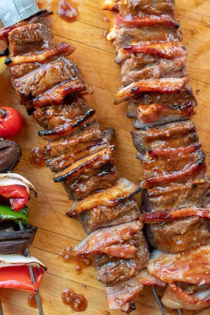 Grilled steak kabobs ready to eat on skewers.