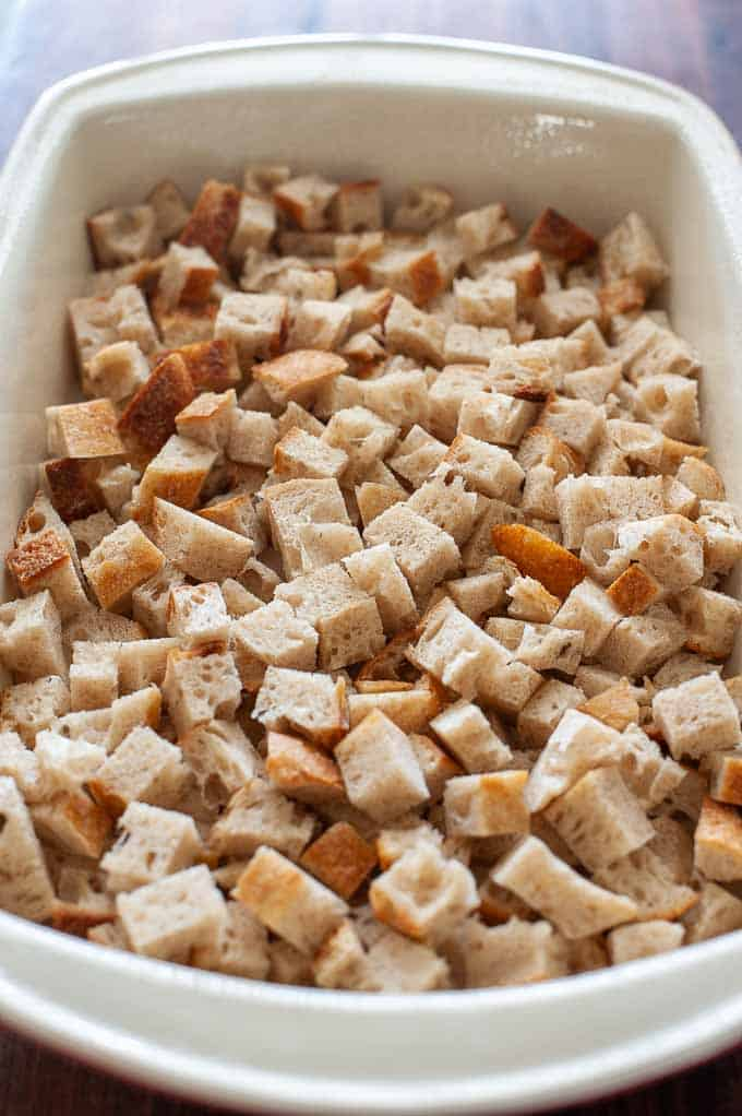 Bread cubes in a baking dish.