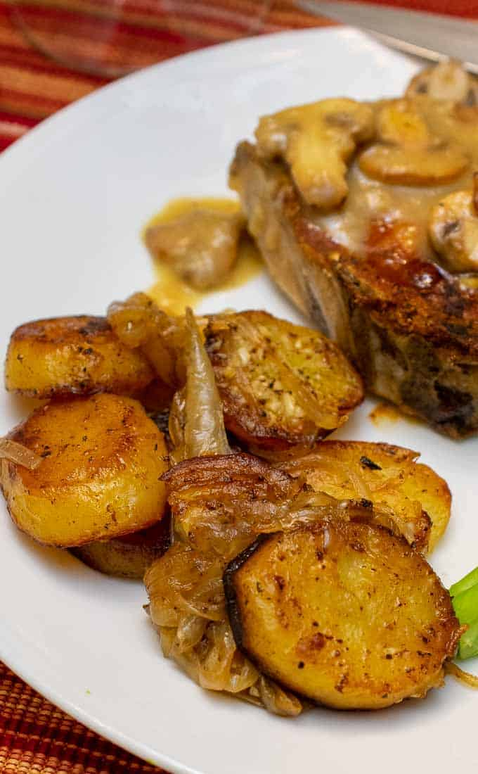 pan fried potatoes and onions on a plate