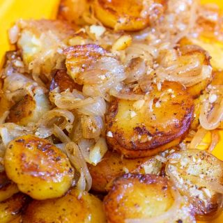 Lyonnaise potatoes in a serving dish.