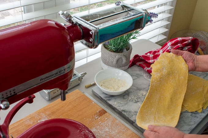 rolling pasta with a Kitchen Aid pasta machine