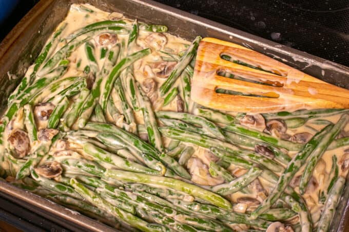 green bean casserole in the baking dish ready for the oven