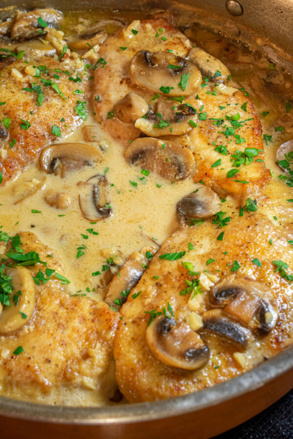 chicken, mushrooms and sauce in a skillet