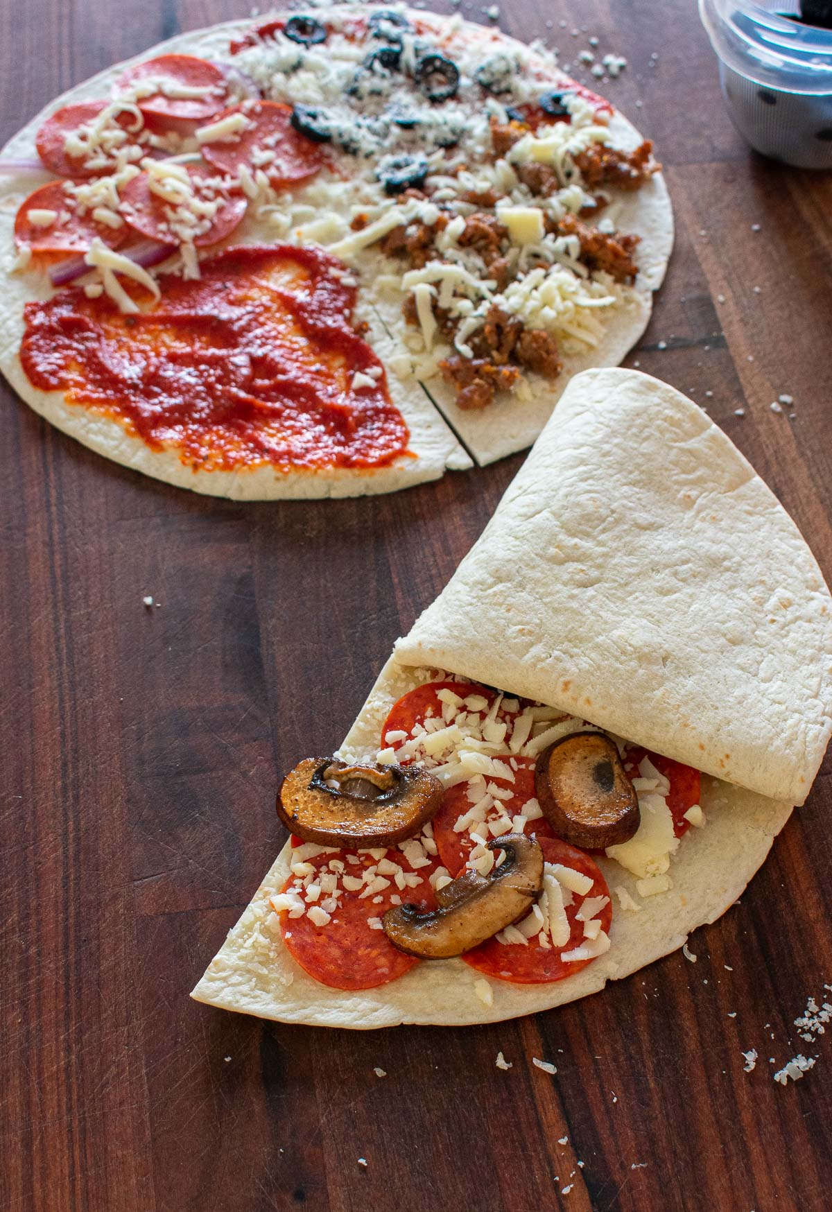 tortilla wrap pizza being folded
