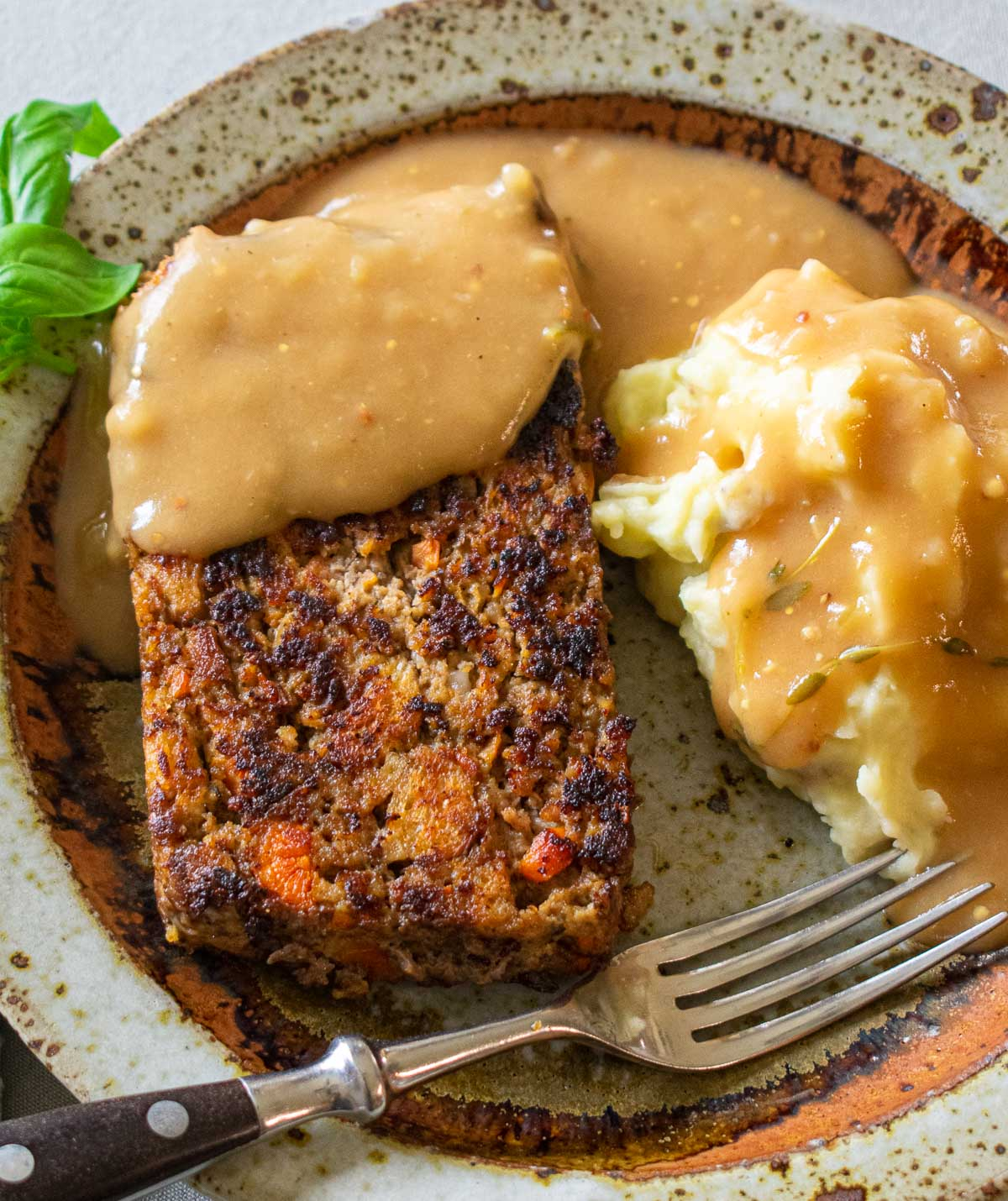 Overhead view of meatloaf, mashed potatoes, and gravy.