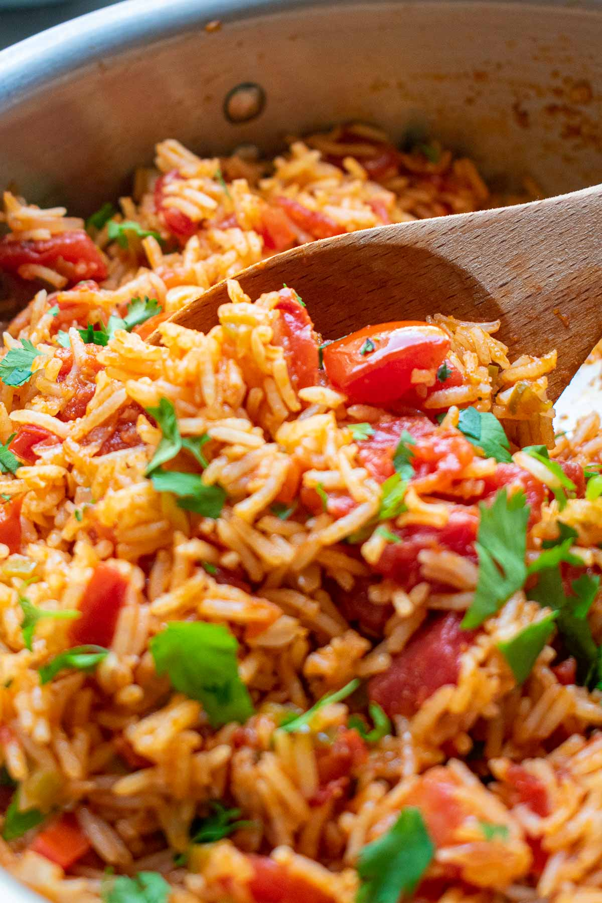 Very close up view of a spoonful of Mexican rice.