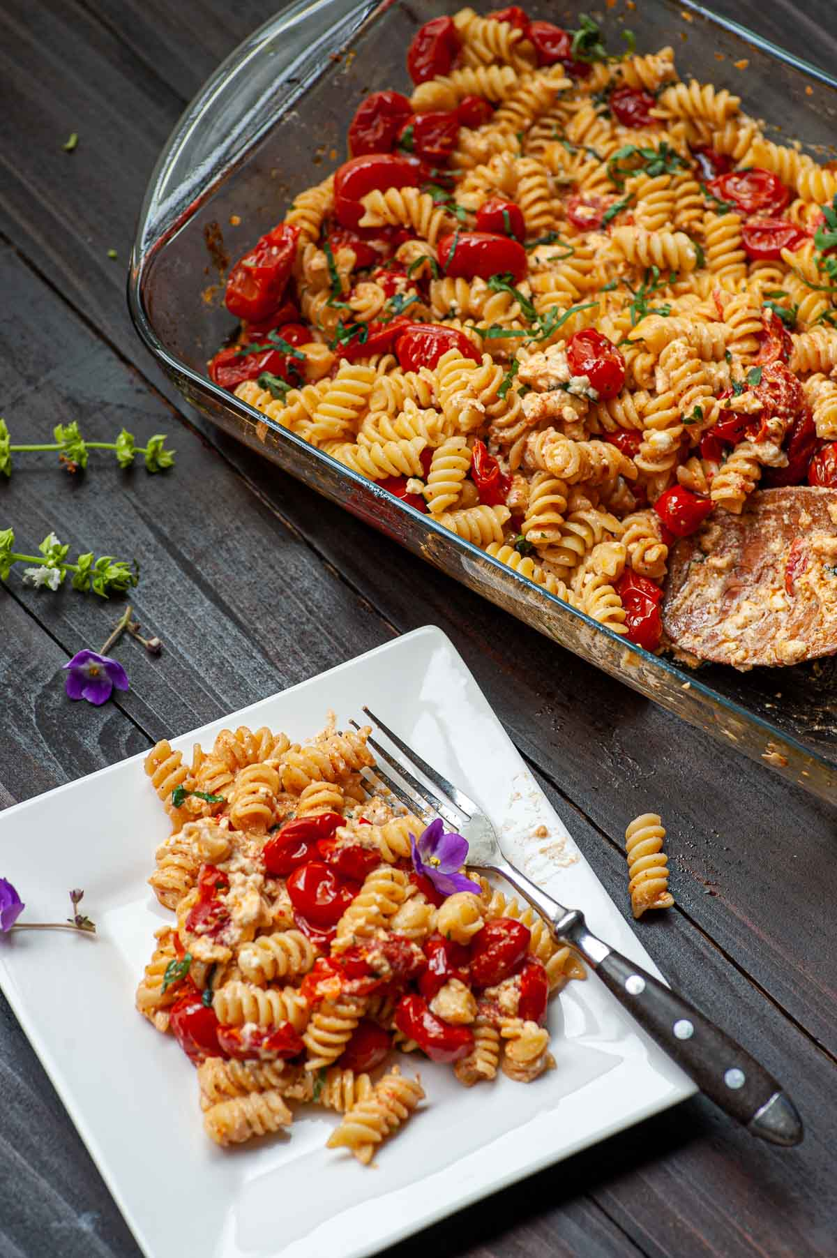 A plate of the pasta next to the casserole.